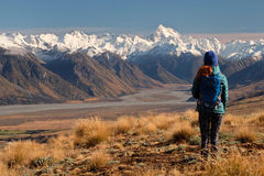 A Hiker Looks Towards The Southern Alps on a Sunny Day. Stock Photo