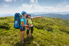 Hiker looks for the way in Carpathian mountains Royalty Free Stock Image