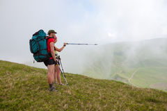 Hiker looks for the way in Carpathian mountains Stock Photo