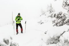 Hiker lost in winter mountains, adventure expedition concept royalty free stock photos