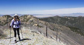 A Hiker Makes Her Way to the Summit of a Mountain Stock Photography