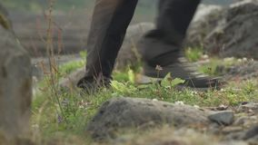 Hiker making steps stock footage