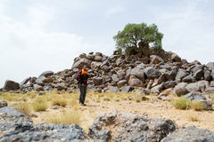 Hiker man in beautiful site in the desert Royalty Free Stock Images