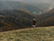 Hiker man climbing the hill Royalty Free Stock Photography