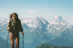 Hiker Man climbing mountains with backpack. Travel Lifestyle concept adventure vacations outdoor rocky mountains landscape on background Stock Photos