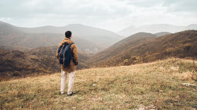 Hiker man enjoying by scenic of mountains Royalty Free Stock Image