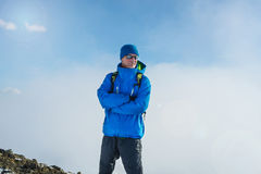 Hiker man having fun in the winter mountains. Stock Photo