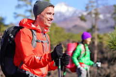Hiker man hiking - healthy active lifestyle Royalty Free Stock Images