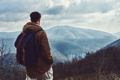 Hiker man looking at the mountains Stock Image