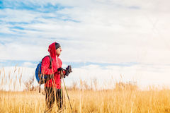 Hiker man  standing in the field and looking at  scenic field landscape Royalty Free Stock Photos