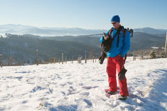 Hiker man standing with  GPS receiver in winter mountains and de Royalty Free Stock Image