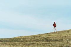 Hiker man standing on the hill Stock Photography