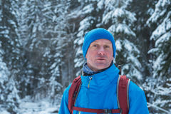 Hiker man standing in winter Stock Image