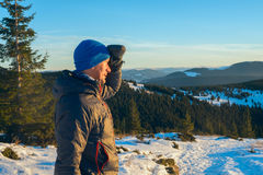 Hiker man standing in winter mountains Royalty Free Stock Photography