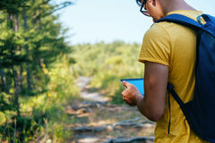 Hiker man with tablet PC Stock Photos