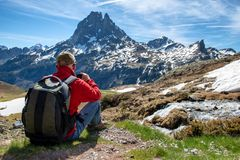 Hiker man take a picture with action camera royalty free stock photography