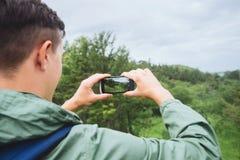 Hiker man taking photographs summer landscape Stock Photo