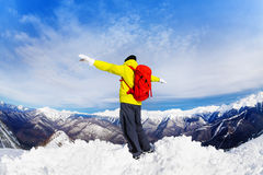 Hiker man on top of snow mountain peak Stock Photography
