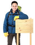 Hiker man tourist with blank wood sign Stock Photography