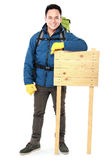 Hiker man tourist with blank wood sign Royalty Free Stock Photography