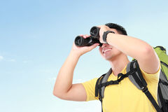 Hiker man tourist looking with binoculars Royalty Free Stock Photos