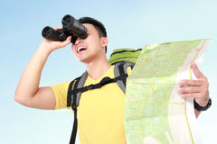 Hiker man tourist looking with binoculars Stock Photos