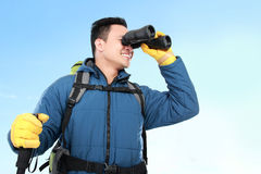 Hiker man tourist looking with binoculars Stock Images