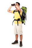 Hiker man tourist looking with binoculars Royalty Free Stock Images