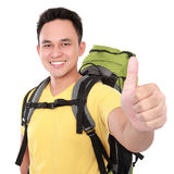 Hiker man tourist with thumb up Royalty Free Stock Images