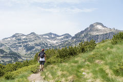 Hiker man walking  in a  high  mountain Royalty Free Stock Photography