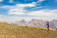 Hiker man walking on the mountain hill. During hiking Royalty Free Stock Image