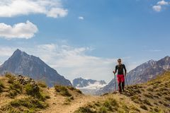 Hiker man walking on the mountain hill. During hiking Stock Photo