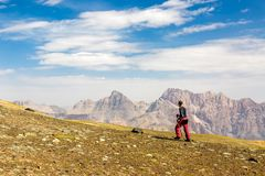 Hiker man walking on the mountain hill. During hiking Royalty Free Stock Photos