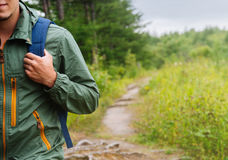 Hiker man walking on path in summer Stock Photo