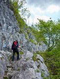 Hiker man walking to a mountain rocky trail Royalty Free Stock Image