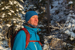 Hiker man in the winter wood Stock Photo
