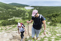 Hiker man and woman  in Pirin mountain,. Tourist  men with backpack and hat  in a high mountain.Beautiful landscape from Bulgaria,Pirin Mountain Royalty Free Stock Image