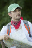 Hiker with map Stock Images