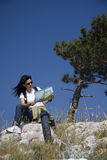 Hiker with map Stock Photo
