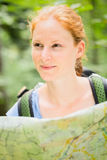 Hiker with a Map in a Forest Royalty Free Stock Photography