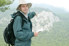Hiker with map while out trekking royalty free stock photo