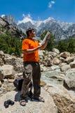 Hiker with map Stock Photos