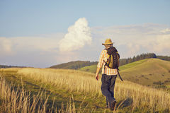 Hiker on meadow Stock Images