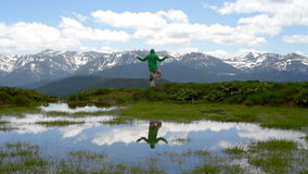 Hiker meditating in the mountains. Happy man hiker meditating in the mountains and lake landscape on background Travel Lifestyle concept adventure summer stock video