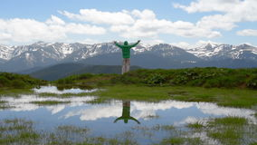 Hiker meditating in the mountains stock video