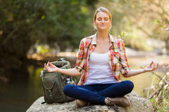 Hiker meditation mountain Stock Photography