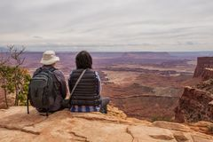 Hiker meets sunset at Grand view point in Canyonlands National p. Ark in Utah, USA Stock Photos