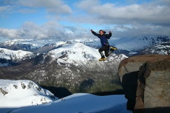 Hiker in mid air jumping off Royalty Free Stock Images