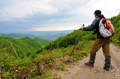 Hiker on a mounatin trek Royalty Free Stock Image
