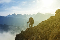 Hiker on a mount slope Royalty Free Stock Images